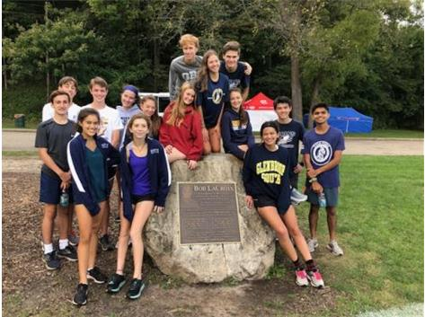 "The GBS Varsity Runners travel to Peoria every year to preview the state meet course.  Gathering near the finish by the ""Lacroix Rock"" has become a great tradition after Friday's practice.  Hall of Fame Coach LaCroix helped bring the state meet to Peoria back in 1970's!"
