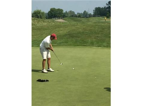 Mark finishing a birdie at Windy Knolls GC..