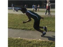 BJ Stewart starts his approach for the long jump.