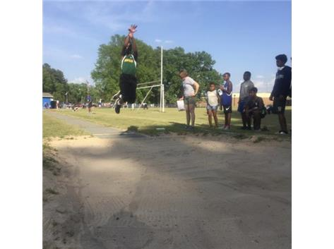 BJ Stewart elevates into the long jump.