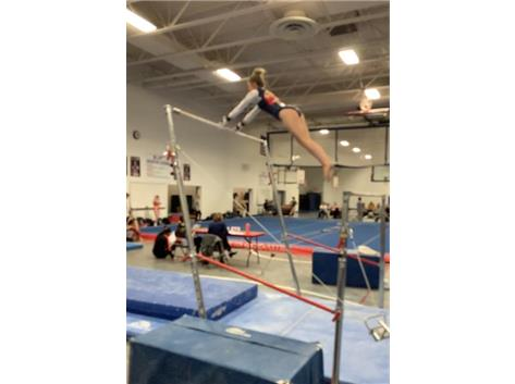 Lizzy Valentine on uneven bars at Warhawk Inv