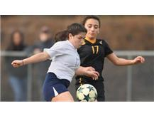 Melissa Flores settles a ball while shielding a defender (Photo Courtesy of Brian O'Mahoney-Pioneer Press/Chicago Tribune Preps)
