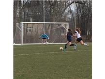 Mia Cianci charges toward the goal