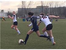 Karen Gutierrez speeds ahead with the ball leaving defenders in her wake