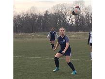 Mia Cianci follows the flight of the ball