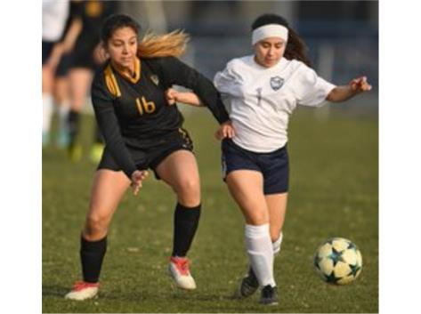 Vikki Cruz controls the ball against Elmwood Park (Photo Courtesy of Brian O'Mahoney-Pioneer Press/Chicago Tribune Preps)