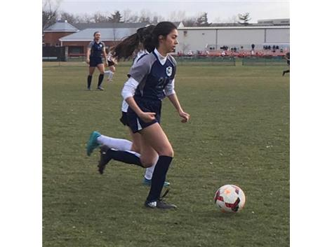 Karen Gutierrez pushes the ball ahead