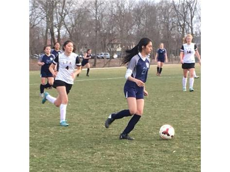 Karen Gutierrez holds the ball looking to go forward