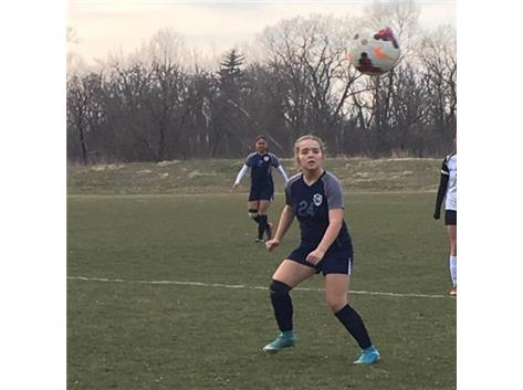 Mia Cianci follows the flight of the ball