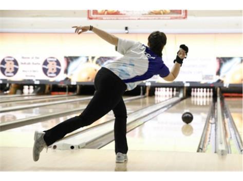 Clara Bowling a Strike