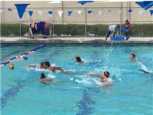 Swim Team having fun at practice playing water polo