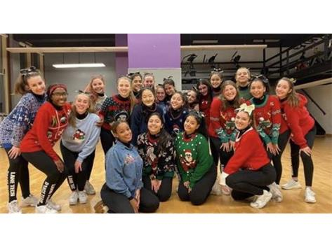 Dance Team Decked Out for the Ugly Sweater Basketball Game