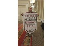 Coach Kindell with 2014 State Poll Champion Banner.