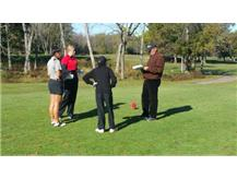 H. Hautzinger at District Tournament scorecard exchange and pre-tee off meeting.
