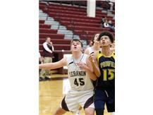 Darian Hughes gets position for a rebound in the freshman game