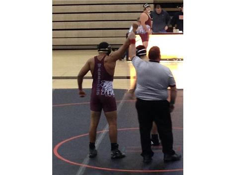Jared Burton records his first career wrestling victory by pin vs. Ryle.