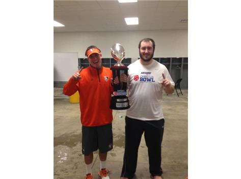 Alex Lockemeyer and Jake Bennett share the 2014 Camellia Bowl Championship trophy following Bowling Green's bowl game win.