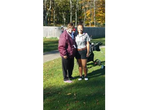 Coach Russell and H. Hautzinger at 2015 District Tournament