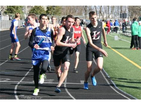 Nick Wayne and Davy Hardie make a successful exchange in the 4x800 relay at Northmont.