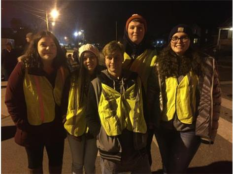 Jess,Mia,Austin,Jaron,and Delaney working the evening parade. Working hard to keep the horses & carriages safe from the thousands of parade goers.