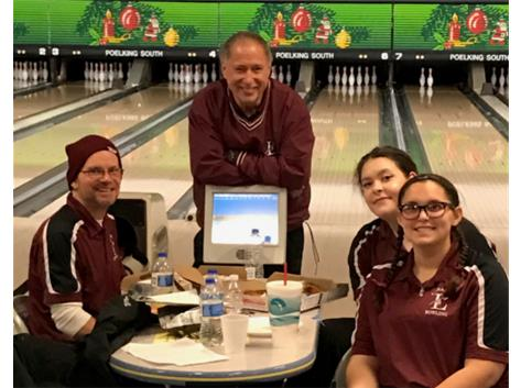 Coach Perkins, Coach Volmering, Jess Schultz, and Delaney Brun waiting on announcement of what teams advanced to finals...we missed by 4 pins!