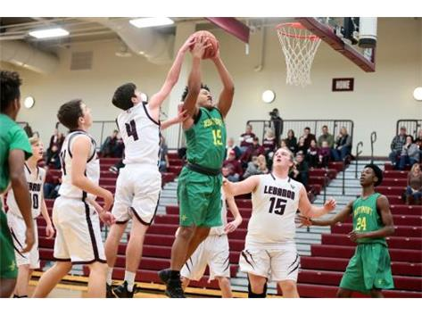 Grant Gardner contests a shot from a Northmont player during a JV game