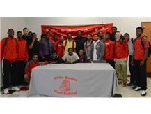 Lots of support as Marquis Miller signs to play at Defiance College next year.