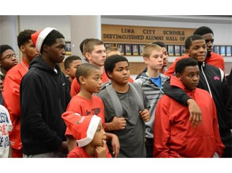 The Spartan basketball team adopted four families for Christmas. Lunch, presents and Santa made for a special day.