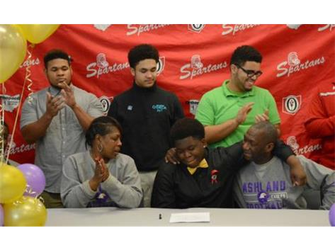 Lots of support from family, teammates and classmates as Khiry Smith-Williams signs with Ashland University.