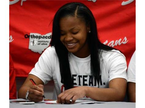 Essence Cowan signs to play basketball at Owens Community College next year.