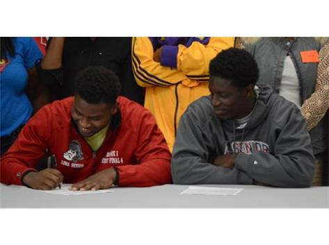 Rico Stafford and Marquevious Wilson sign to continue their education and play basketball next year at Owens Community College.