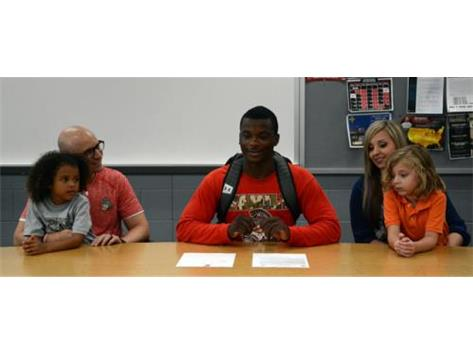 Miguel Clark signs his National Letter of Intent to play football at Hocking College next year.