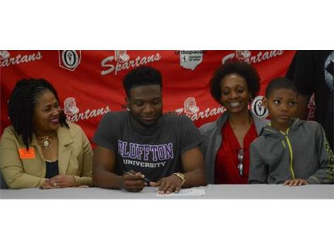 Spartan Gary Wilson signs his National Letter of Intent to play football at Bluffton University.