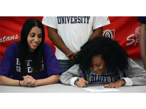 Lima Senior's Tajah Upshaw signs her National Letter of Intent to play soccer at Bluffton University.