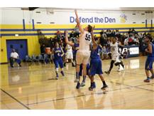 Ryan Simpson scoring a layup - Holiday Tournament