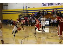 Tyrell Pettis driving towards the basket.