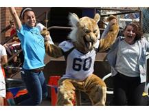 Willie the Wildcat Jumps for joy with some other Wildcats!