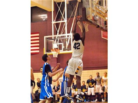 Junior Allen Obazee dunking in the Regional Championship game