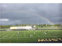 It poured the whole match, but the rainbow came out just at the end. And, yes, we won the match!