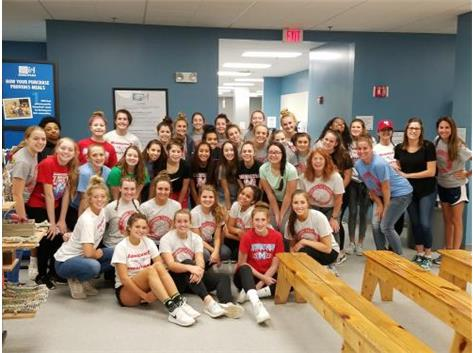 Marian Central Volleyball program volunteering at Feed My Starving Children. 10/3/18