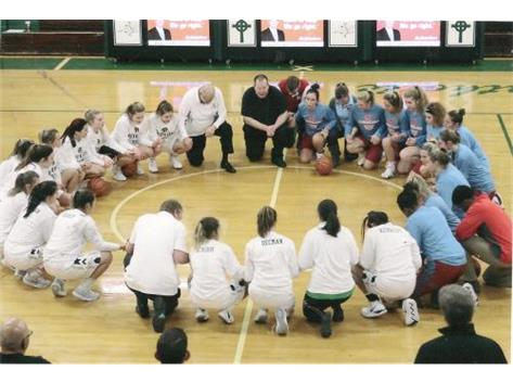 Marian Central and Boylan prayer circle prior to the Reindeer games tournament at Boylan 12-27-18.