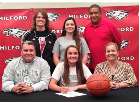 Kelly Noll committed to play basketball at Wilmington College. Front: Joe Noll (father), Kelly Noll, Kris Noll (mother) Back: Kristi McKenney (MHS head coach), Katie Noll (sister), Tony Gentry (MHS assistant coach)