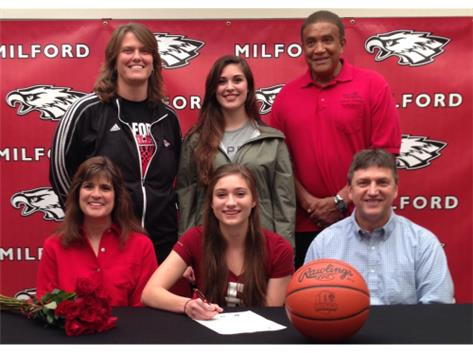 Hannah Woody committed to play basketball at Rose-Hulman Institute of Technology. Front: Deborah Woody (mother), Hannah Woody, Daniel Woody (father) Back: Kristi McKenney (MHS head coach), Kaitlyn Woody (sister), Tony Gentry (MHS assistant coach)