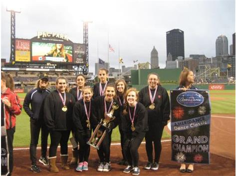 Varsity Hip Hop Team receiving their trophies and banner on the field at PNC Park!