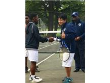 #2 Singles player Cristofer Gomez-Martinez greets his opponent during player intros.