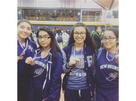 The freshman girls 4x400 relay team earns medals on 12/20/16 Trizy, Maria del Carmen, Irania, and Aliyah