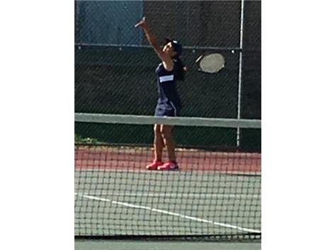 Prepares to serve to her opponent at Edison HS.