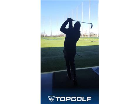 At Topgolf practicing