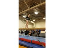 Freshman Lauren Rosenfeld competing her beam routine.