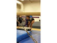 Pez getting ready to compete beam, adjusting her board by a millimeter.